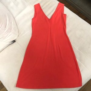Moda International bright orange V-neck dress.